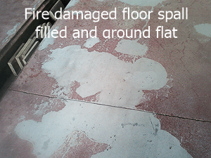 Concrete floor spall from fire damaged ,repaired and ground flat